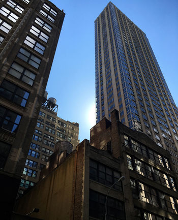 Looking up at several skyscrapers in New York - Garment district EyeEmNewHere New York New York City Architecture Building Exterior Built Structure City Clear Sky Day Garment District Low Angle View Modern No People Outdoors Skyscraper Tower Towers Travel Destinations Windows