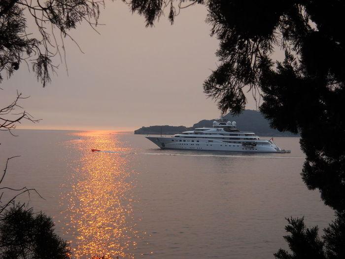 SvetiStefan💙 FreshonEyeem Montenegro🌊💙👈 Travel Destinations Sea Tourism Royal Beach Boats⛵️ Sunset