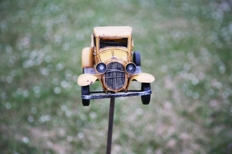 Close-up of toy car decor in back yard