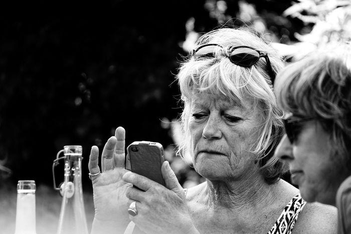 Texting On The Phone Mobile Phone Aged Beauty Age Is Just A Number Wrinkles Monochrome The Difference Is Spreading Snapshots Of Life Street Photography Black And White Bnw_collection Blackandwhite Photography People And Places Luncheon Meat