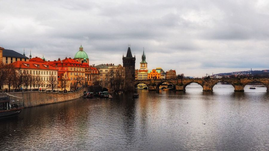 Charles Bridge / Praha Architecture Building Exterior Built Structure Sky River Cloud - Sky City Government Travel Destinations Water Bridge - Man Made Structure Cityscape Outdoors No People Day First Eyeem Photo Carnival Crowds And Details