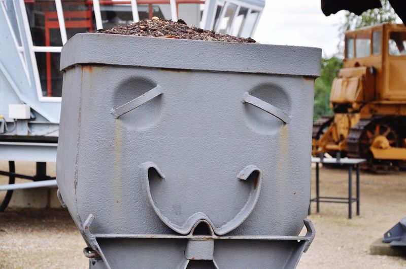 Anthropomorphic Smiley Face On Metal At Industry