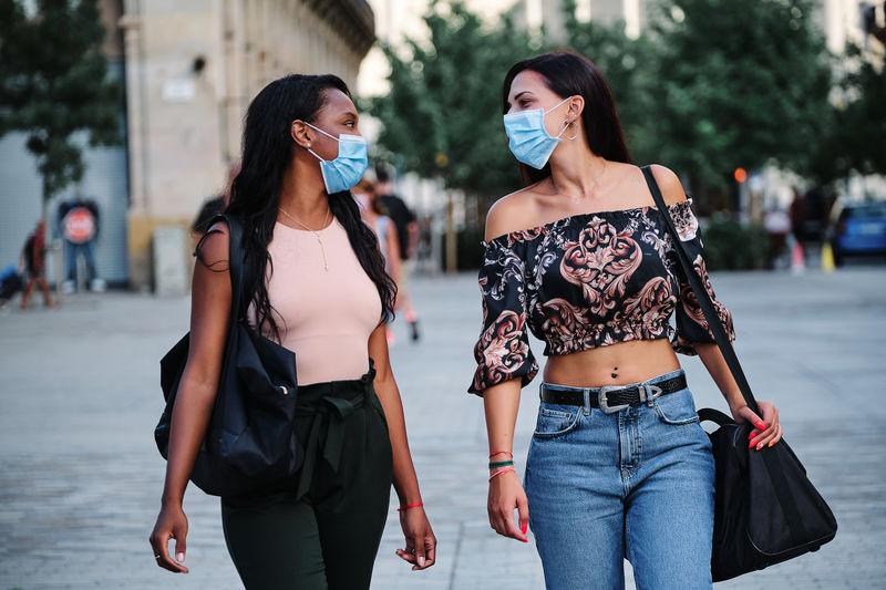 Women walking on street in city