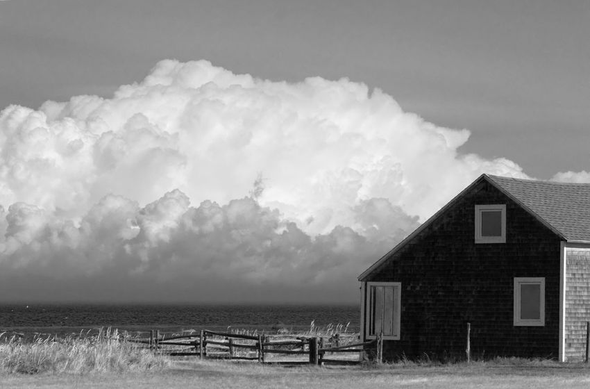 A quiet little house facing the sea and the stormy clouds at large. Picture taken in Rimouski in August 2017. Stormy Clouds Stormy Weather Architecture Beach Beauty In Nature Black And White Friday Building Exterior Built Structure Cloud - Sky Day Horizon Over Water Nature No People Outdoors Sand Scenics Sea Sky Stormy Sky Tranquil Scene Tranquility Water