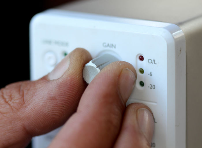 Cropped hand of person holding thermostat