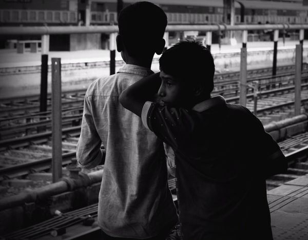 Having a thousand friends isn't a miracle, but is to have a friend who will stand by you when thousands are againt you. Canonphotography Canon Monochrome Togetherness Love Young Couple Passion Embracing Warm Feeling Railroad Station Expose EyeEm EyeEm Gallery EyeEm Best Shots