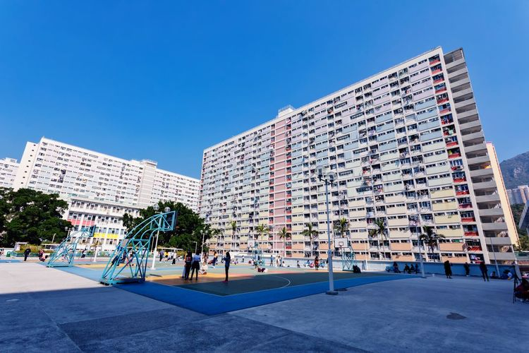 Rainbow Village, Hong Kong Prosperous City Urban Style Pearl Of The Orient Financial Center Tourist Attraction  Special Administrative Region Blue Sky China HongKong Landscape Tourism Color Cityscape Development Of Scenery Bustling Shopping Haven Rainbow Village City Modern Clear Sky Sky Architecture