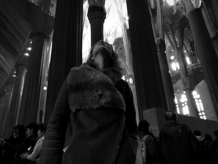Low angle view of woman standing in corridor