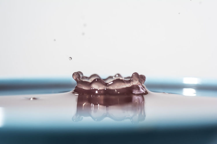 Close-up of splashing water against gray background