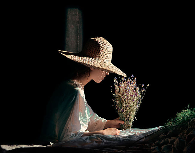 STILL LIFE Black Background Day Flower Hat Indoors  One Person People Real People Young Adult