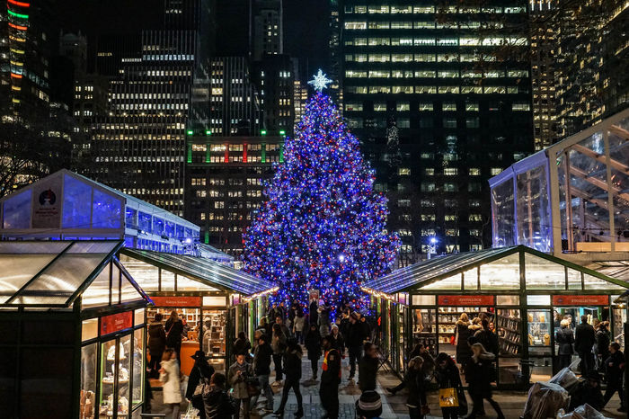 Night time in NYC with a little cheer. Architecture Bryant Park  Bryant Park NYC Celebration Christmas Christmas Decoration Christmas Lights Christmas Market Christmas Tree City Illuminated Midnight New York Night Nightlife Nightphotography NYC NYC Parks Outdoors People Skyscraper Travel Destinations Winter Village Winter Village Bryant Park