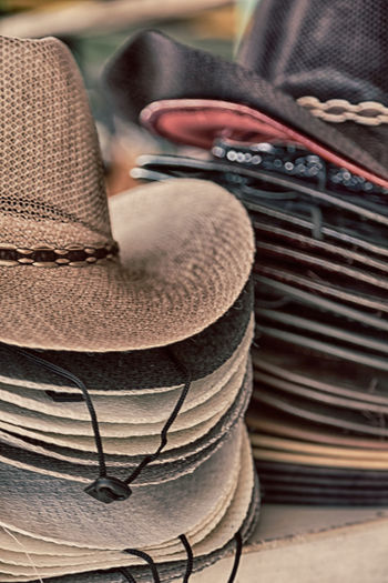 Close-up of hats stack for sale