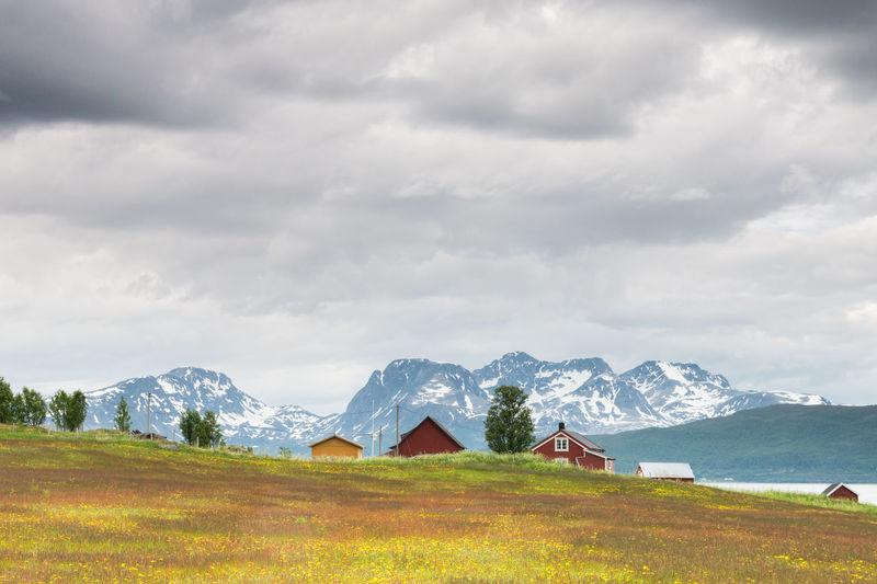 Beauty In Nature Cabin Cloud Cloud - Sky Cloudy Colourful Dramatic Sky Fjord Grass Landscape Meadow Mountain Mountain Range Nature Northern Norway Scenics Season  Sky Weather Summer The Essence Of Summer Snarby