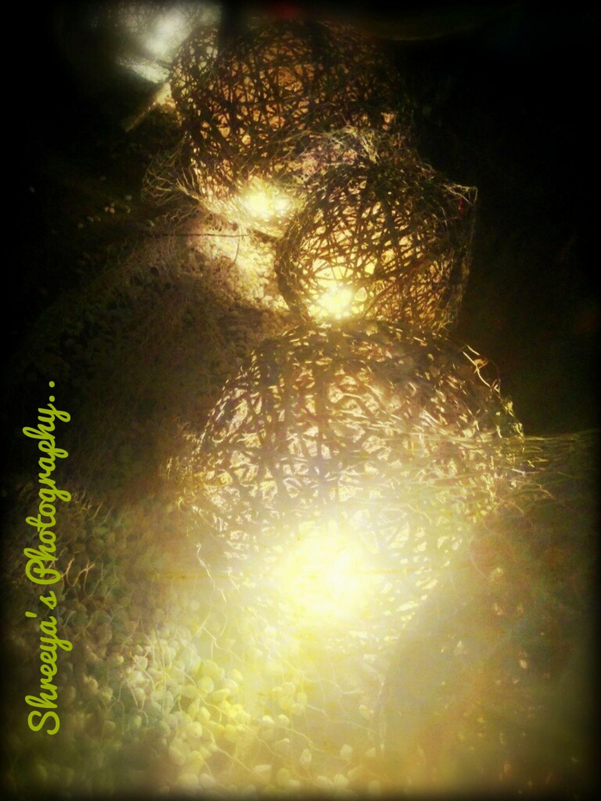 illuminated, night, glowing, lighting equipment, light - natural phenomenon, decoration, light, reflection, indoors, lit, pattern, motion, celebration, long exposure, no people, low angle view, water, electricity, dark, firework display