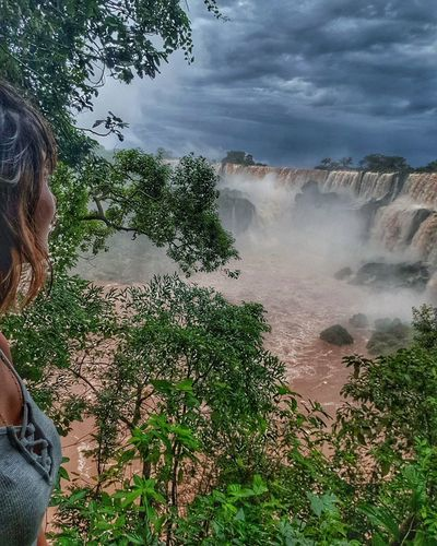 Woman looking at view of waterfall