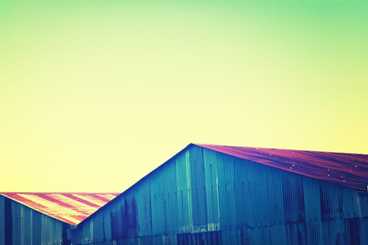 copy space, clear sky, built structure, no people, architecture, outdoors, building exterior, day, roof, sky, blue, corrugated iron