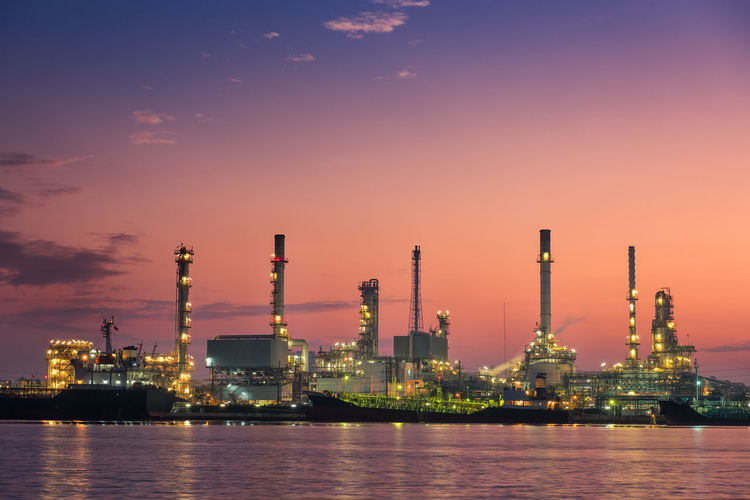Oil and gas refinery plant Loading Dock Architecture Building Exterior Built Structure Business Chemical Chemistry Distillation Dock Environment Factory Fuel And Power Generation Illuminated Industry Manufacturing Equipment Nature Oil Oil Industry Outdoors Pollution Refinery Sky Stack Tower Sunset Water