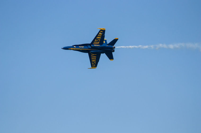 Navy Blue Angels Aerobatics Aerospace Industry Air Force Air Vehicle Airplane Blue Clear Sky Copy Space Day Flying Low Angle View Mid-air Military Airplane Mode Of Transportation Motion Nature No People on the move Outdoors Plane Sky Transportation Travel Vapor Trail