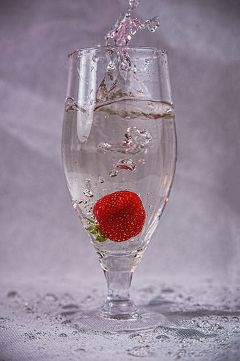 Close-up of wineglass on glass