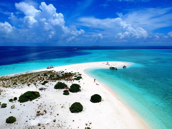 Beautiful white sandbank surrounded by layers of blue water and coral reef in Maldives Maldives Vacation Ocean Blue Water Layer Shallow Deep Sandbank View Crystal Visit Tour Trip Excursion Blue Ocean Clouds White Peaceful Relax Inhabited Green Coral Reef Beach Sea Island Sand Cloud - Sky Turquoise Colored Idyllic Blue Sun Sky Tropical Climate Vacations Horizon Over Water Nature Travel Destinations Landscape Water Travel Scenics Go Higher