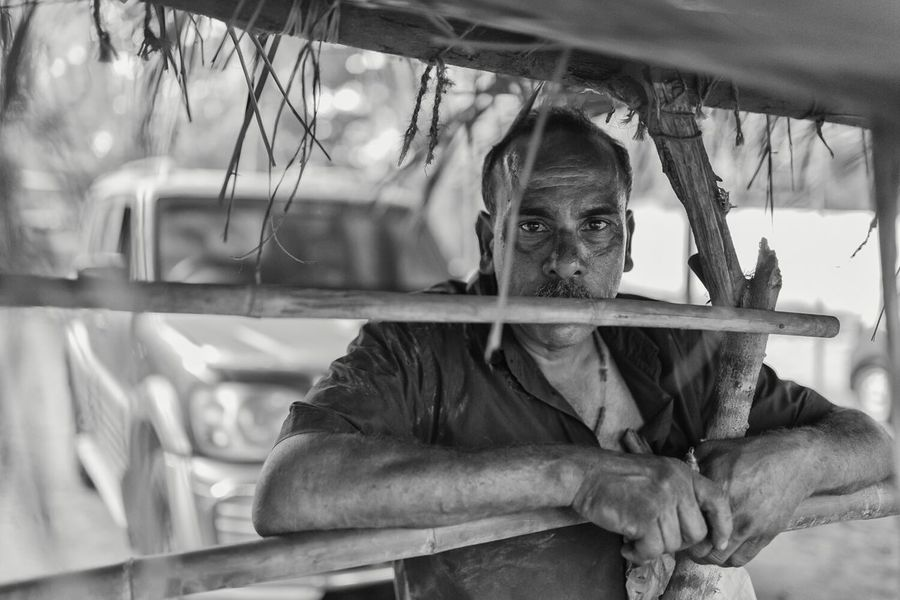 A portrait from my repairmen series that I worked on in Goa. This man repaired cars on a parking lot behind a small church. EyeEm Best Shots India Monochrome Shootermag The Photojournalist - 2015 Eyeem Awar Goa Portrait