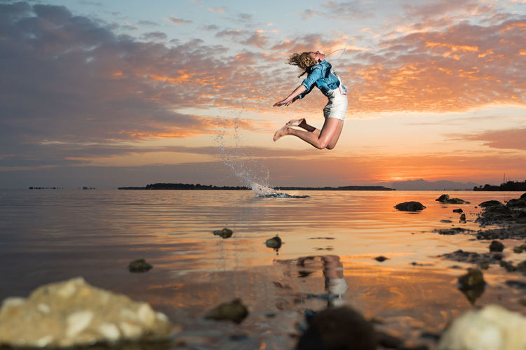 Adult Adults Only Adventure Beach Beauty In Nature Day Full Length Jumping Mid-air Motion Nature One Man Only One Person Only Men Outdoors People Reflection Sea Sportsman Stunt Sunset Vacations Water Young Adult