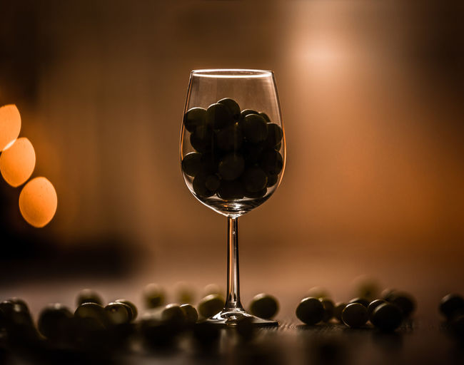 Close-up of food in wineglass on table