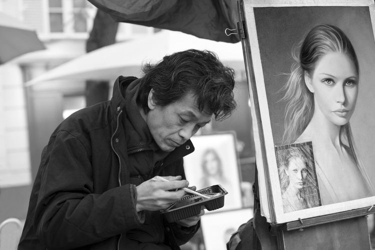 Place du Tertre, Montmartre, Paris, France Art Casual Clothing Easel Eating Focus On Foreground Food France Full Frame Lifestyles Market Montmartre Painter Painting Paris Person Place Du Tertre Selective Focus Young Woman