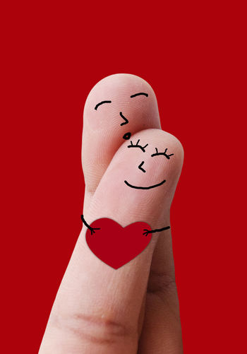 Finger Love Happiness Love Romantic Sweet Dreams Valentine Valentine's Day  Adults Only Anthropomorphic Face Anthropomorphic Smiley Face Creativity Cute Day Fingers Happiness Human Body Part Human Hand Human Representation Humor Lovely One Person People Red Red Background Studio Shot