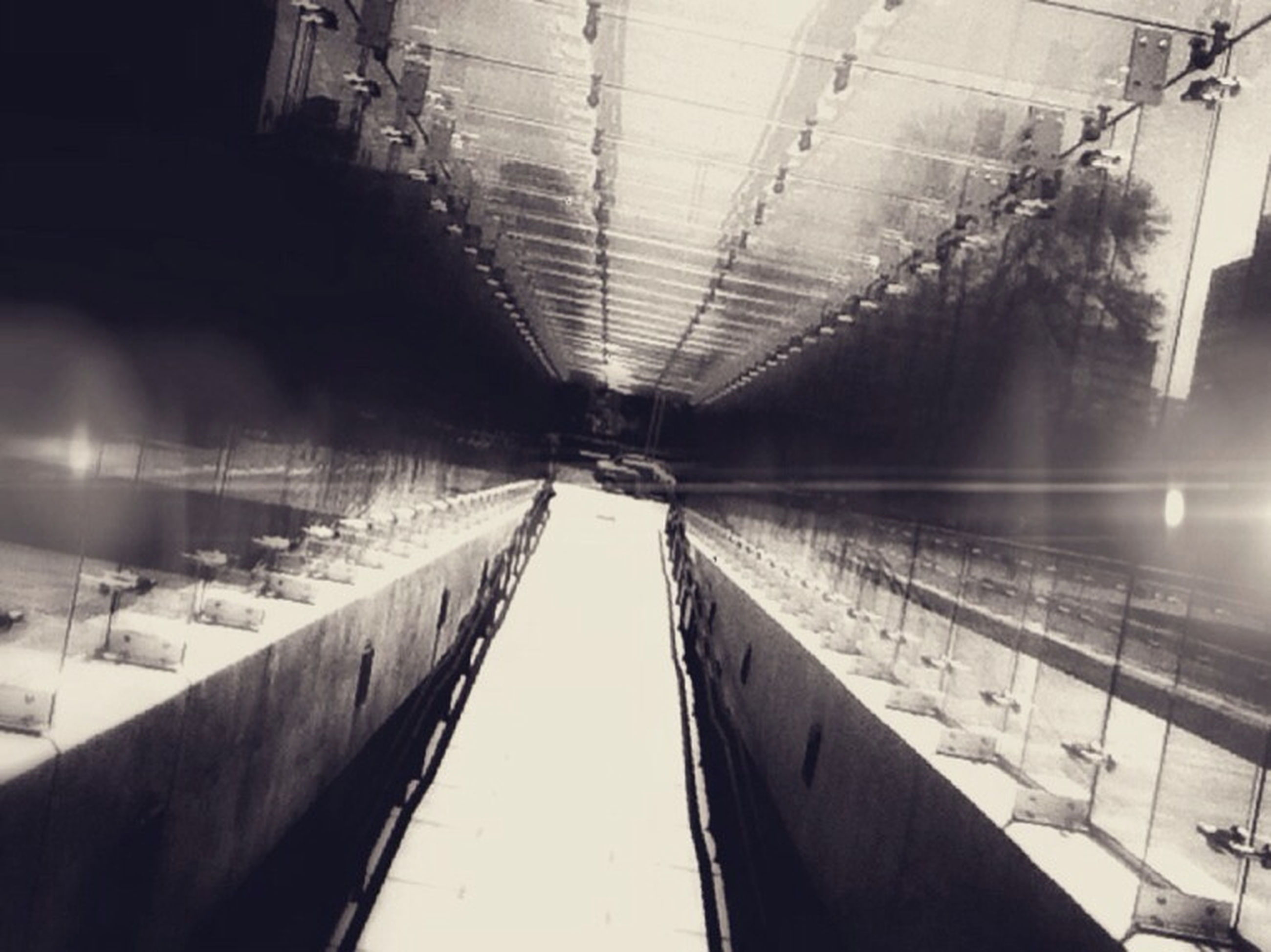 built structure, architecture, ceiling, low angle view, reflection, indoors, diminishing perspective, sky, transportation, connection, water, the way forward, modern, no people, day, vanishing point, glass - material, building exterior, cloud - sky