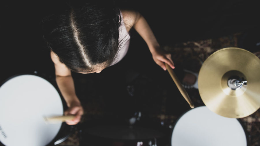 High angle view of girl playing musical instrument