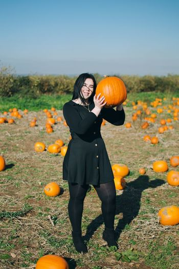 EyeEm Selects Pumpkin One Person Food And Drink Plant Nature Food Leisure Activity Day Full Length Women Land Standing Real People Healthy Eating Field Orange Color Outdoors Freshness Front View Holding Autumn Mood
