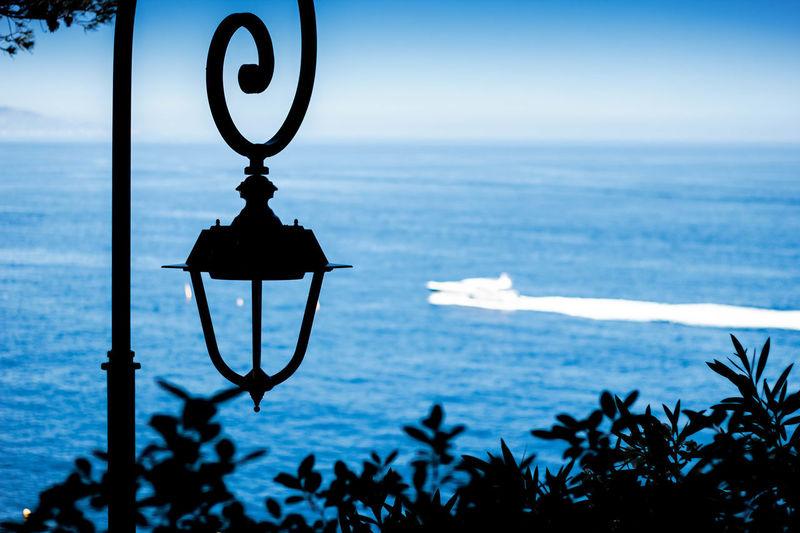 lampe post and the ocean EyeEmNewHere Summer Ocean Lamp Post Blie Sea Horizon Over Water Focus On Foreground Water