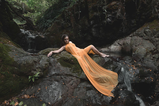 Mary Tree Rock One Person Young Adult Real People Rock - Object Forest Full Length Nature Young Women Solid Women Leisure Activity Dress Fashion Adult Lifestyles Land Plant Hair Beautiful Woman Outdoors