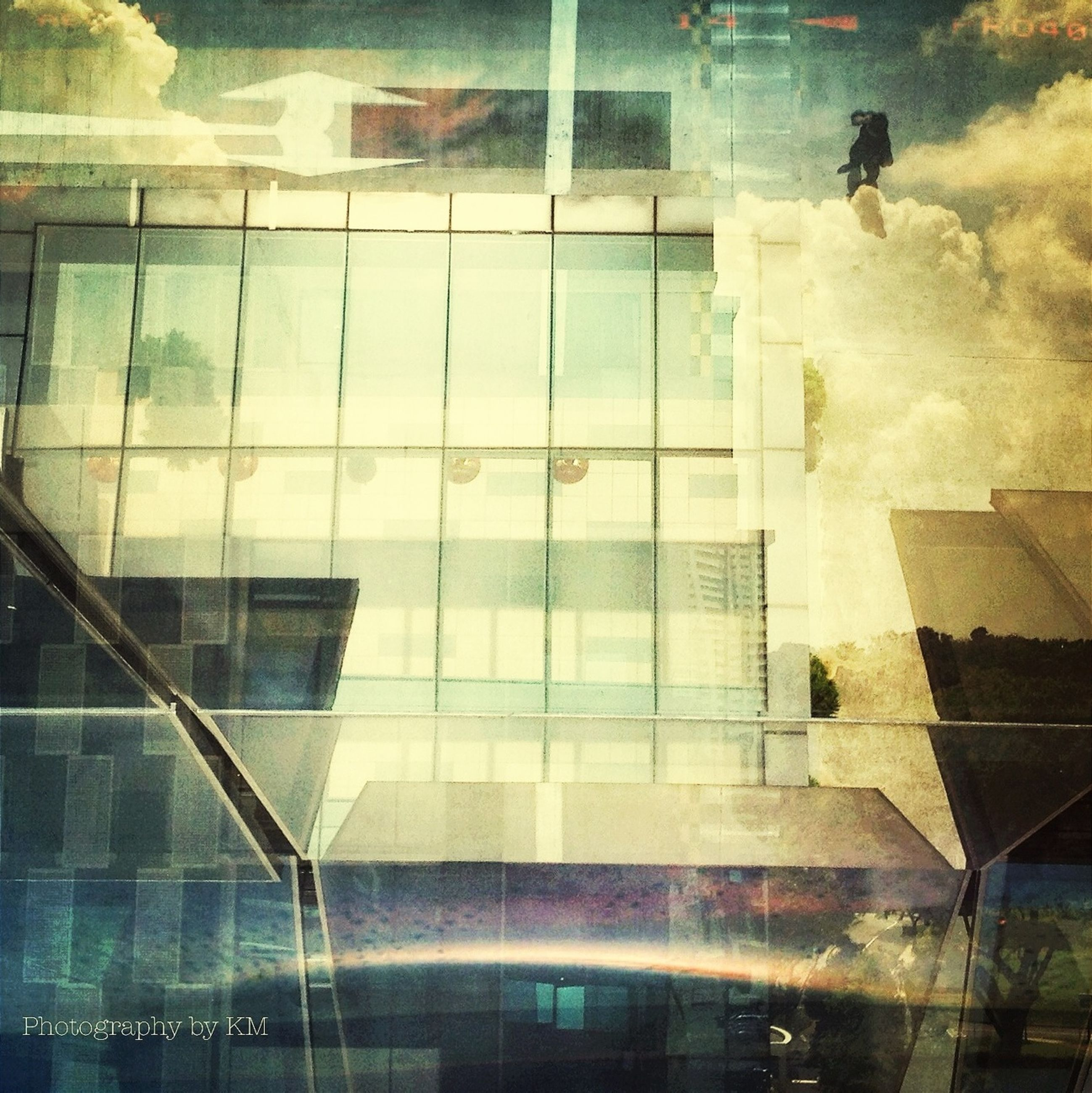 reflection, glass - material, indoors, transparent, window, architecture, built structure, water, modern, glass, building exterior, tiled floor, building, tile, pattern, day, high angle view, sunlight, wall - building feature, city