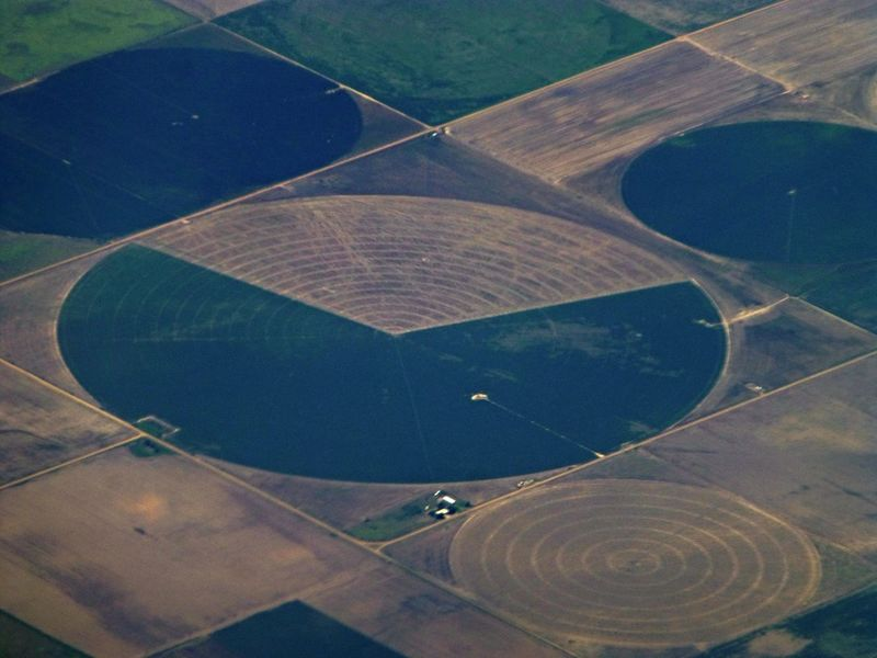 AI Now Agriculture Circle Earth EueEmNewHere Industrial Photography Industry Aerial View Agriculture Photography Air Vehicle Airplane Circles Day Flying Geometry Ground High Angle View Industrial Landscapes Landscape Nature No People Outdoors Patchwork Landscape Scenics
