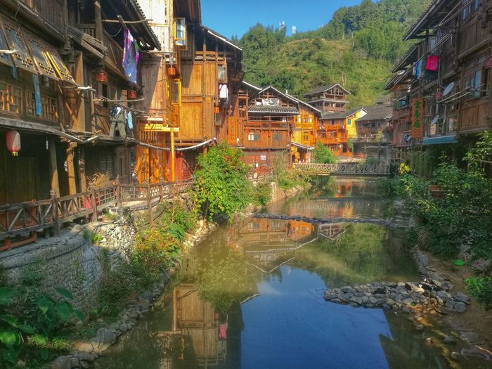 Water Architecture Reflection Built Structure Building Exterior Canal Waterfront Residential Building Mountain Tranquility Scenics Tranquil Scene Day Outdoors Nature Narrow Multi Colored No People Beauty In Nature Standing Water