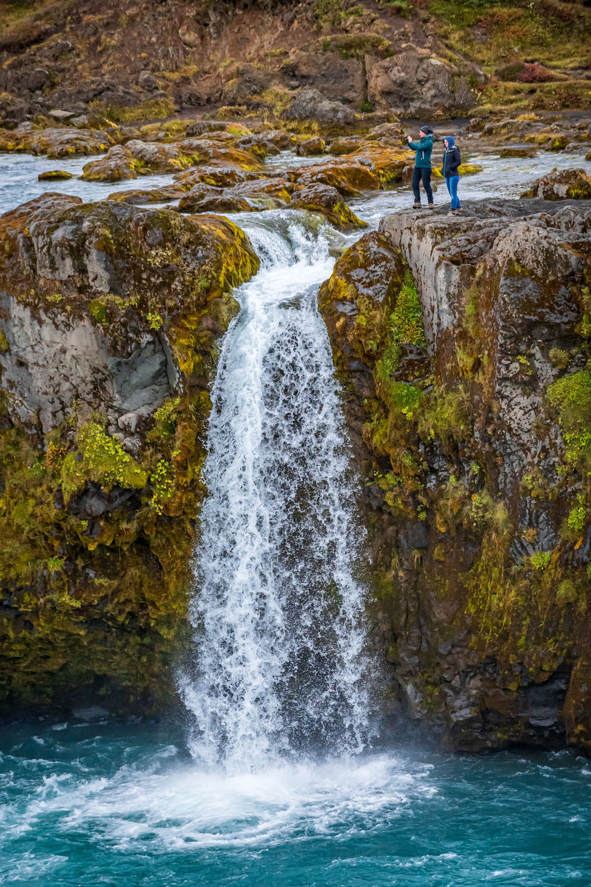SCENIC VIEW OF WATERFALL IN STREAM