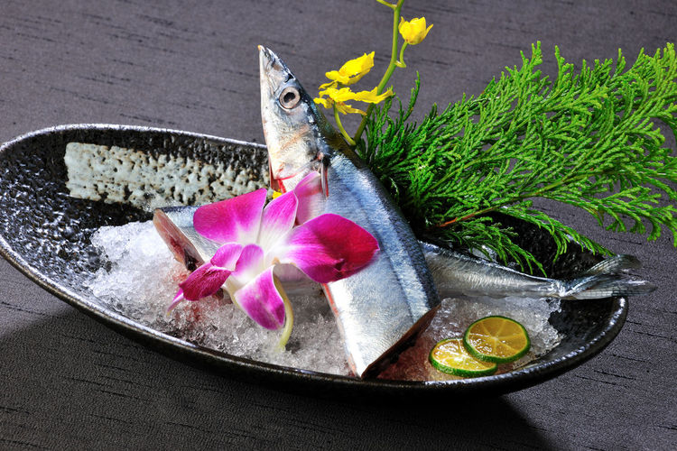 Beauty In Nature Day Delicious Delicious Food Fish Flower Flower Head Food Fragility Fresh Freshness Grilled Japanese-style Food Nature No People Orchid Outdoors Petal Satisfy Saury Seafood Taiwan Water