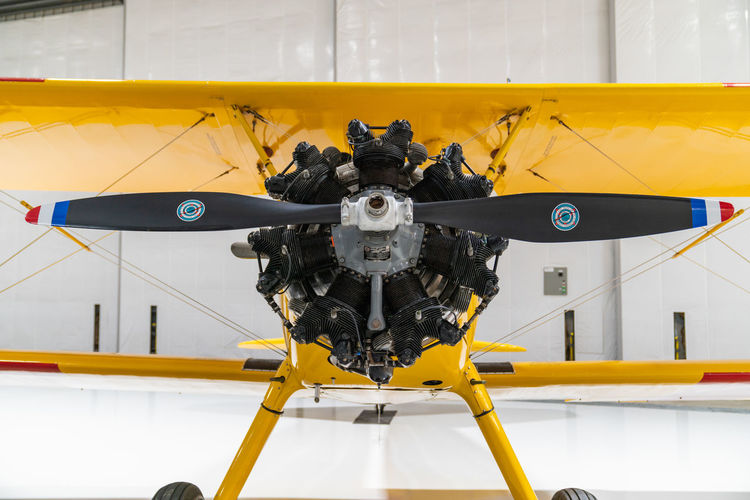Close-up of jet engine at airplane hangar