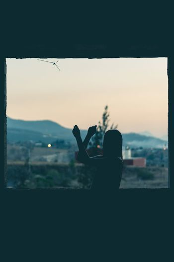 I saw you close your eyes. Human Hand Sunset Togetherness Silhouette City Women Sky Friend Outline Palm Frond High Section Mid Distance Calm Camera Female Photographing Digital Camera Camera - Photographic Equipment