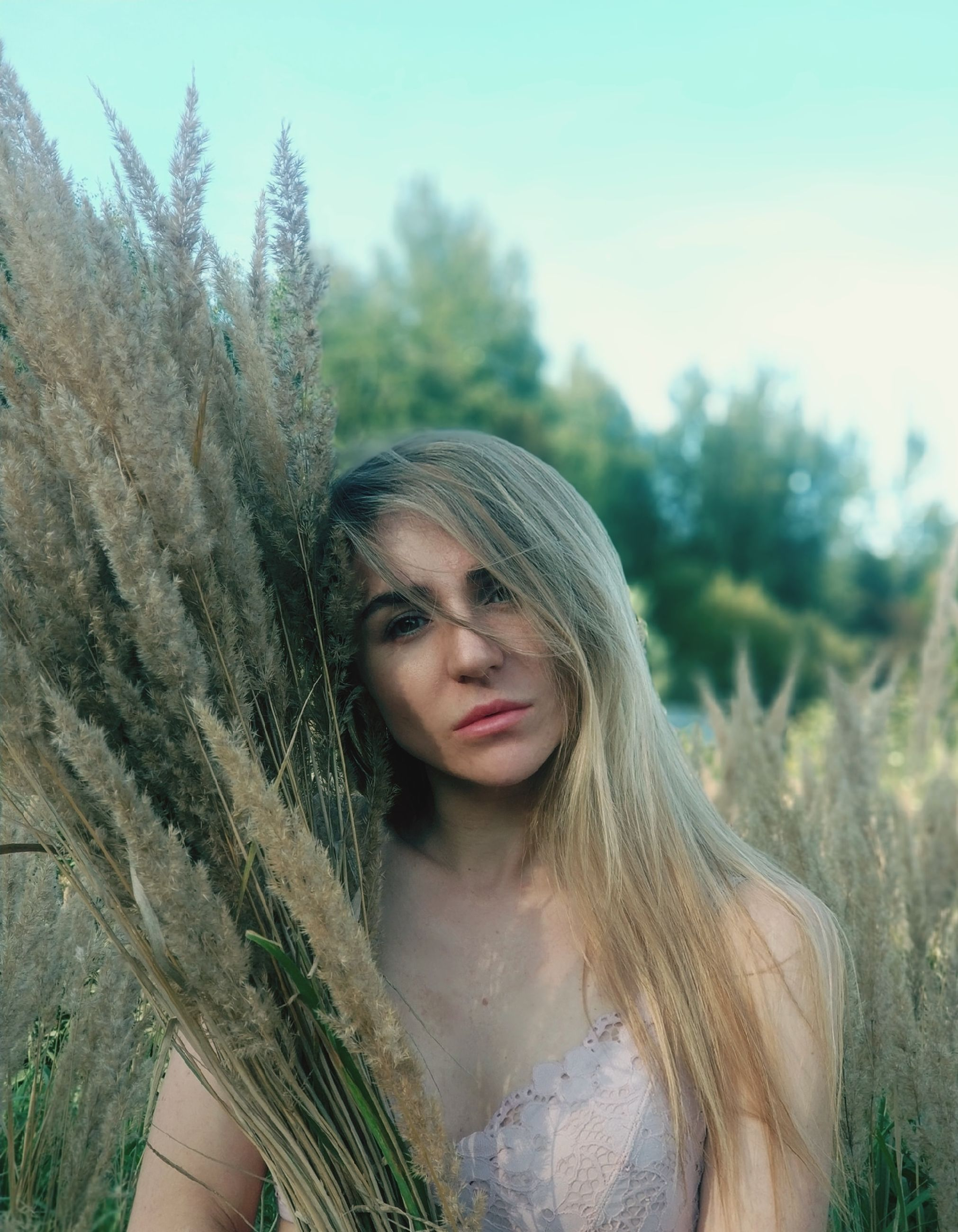 plant, one person, real people, young adult, long hair, hair, young women, lifestyles, land, women, portrait, leisure activity, hairstyle, beautiful woman, nature, tree, front view, day, outdoors