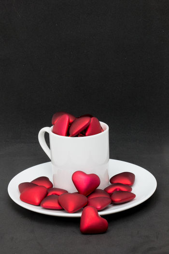 Cup overflowing with love Love Romance Valentine Valentine's Day  Black Background Coffee Cup Heart Overflowing Red Saucer Studio Shot