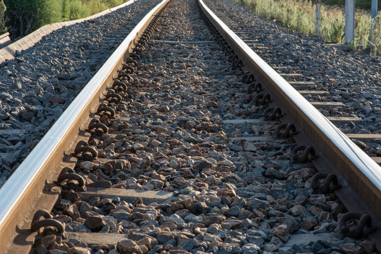 Travel Rail Transportation Railroad Track Track Transportation Solid Rock Gravel Direction Metal Stone - Object Rock - Object Nature The Way Forward Day Pebble Diminishing Perspective No People Railroad Tie vanishing point Outdoors Long Parallel