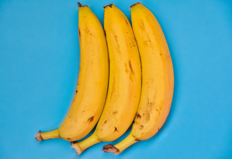 Close-up of bananas against blue background