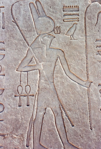 A wall carving, depicting the Falcon headed god, Hathor - Luxor Temple, Luxor, Egypt Architecture Day Indoors  Close-up Ankh No People Luxor Temple Hathor Ancient Civilization Wall Carving Luxor, Egypt Shepherds Crook Thebes Falcon Headed God