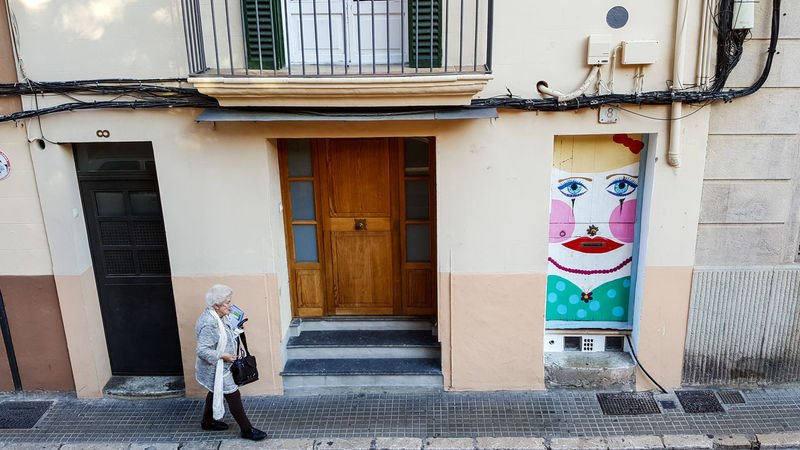 Architecture Building Exterior Built Structure Doors Elderly Human Representation Old Person Old Woman Outdoors Palma De Mallorca People Portrait Real People SPAIN Street Streetart Streetphotography Walking Art Is Everywhere