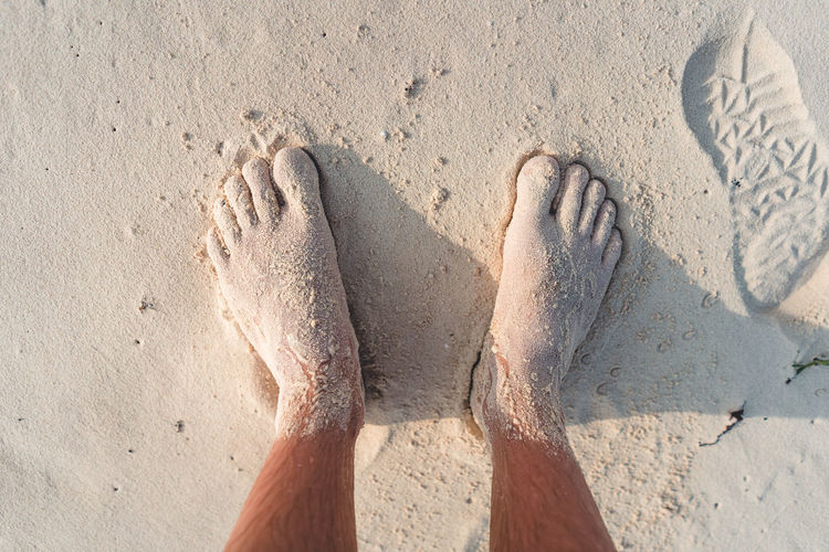 Sand Beach Land Sunlight Nature High Angle View Day Human Body Part Body Part Human Leg barefoot One Person Low Section Personal Perspective Outdoors Human Foot Directly Above Leisure Activity Unrecognizable Person Human Limb