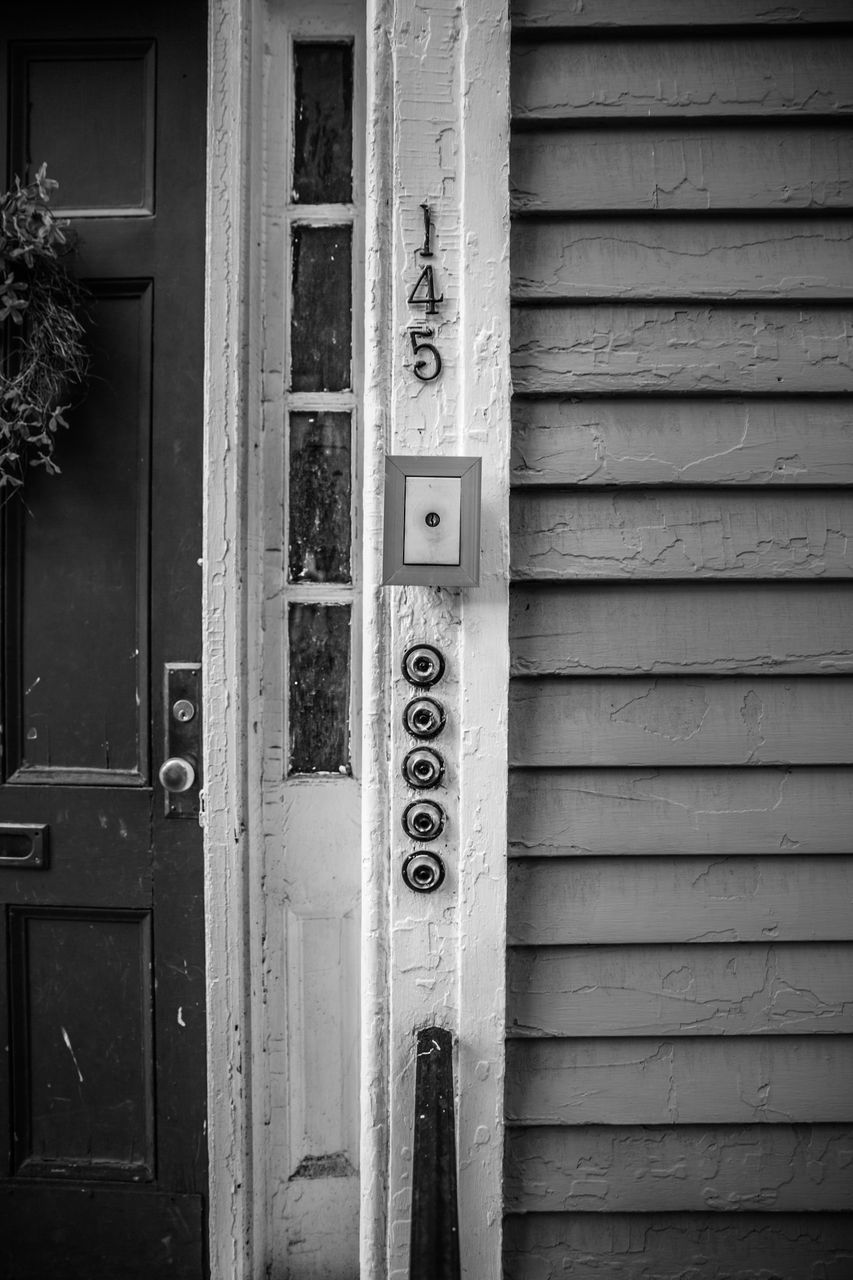entrance, day, text, door, communication, wood - material, no people, number, closed, architecture, western script, built structure, building exterior, metal, pattern, outdoors, security, close-up, safety, protection, garage