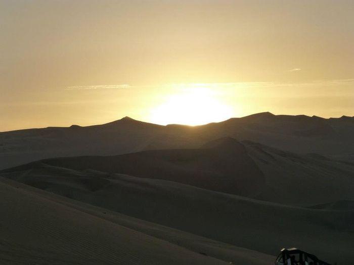 Sky Scenics - Nature Sunset Beauty In Nature Sun Sunlight Mountain Range Arid Climate Travel Rolling Landscape Outdoors Land Tranquil Scene Landscape Desert Desert Sunset